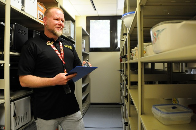Doug Schwab, Army Community Service Relocation Readiness Program manager, inventories items at the Lending Hangar.