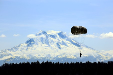A Guardsman with Alpha Company, 1st Battalion, 19th Special Forces Group, parachute past Mount Rainier on Joint Base Lewis-McChord, May 5, 2019.