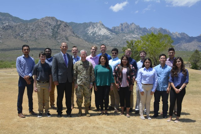 Students in the STEM internship program at White Sands Missile Range, N.M. pose for a photo with WSMR Commander Brig. Gen. Greg Brady and Executive Director Richard Meador outside the Frontier Club June 3.
