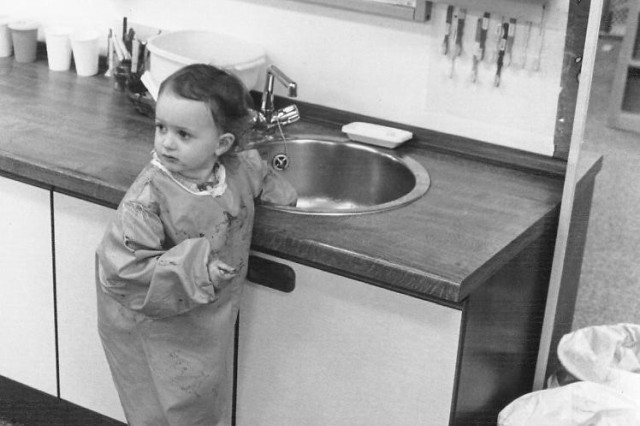 A youngster uses the sink in an Army day care center in this undated U.S. Army photo.