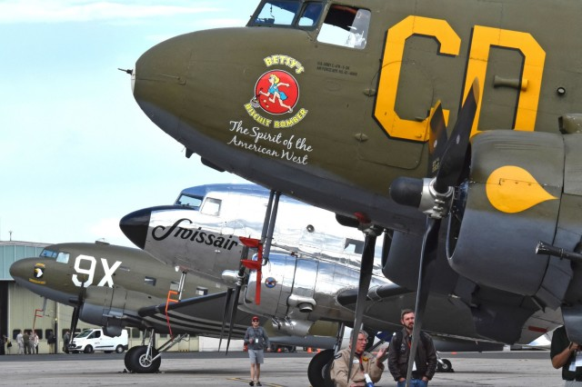 Three C-47 Skytrain aircraft sit on the airfield at Clay Kaserne during the June 10 and 11, 2019, Berlin Airlift 70th Commemoration. Seventeen C-47s arrived for the event along with four T-6 Texans. (U.S. Army photo by Emily Jennings)