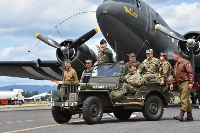 """The """"Candy Bomber,"""" retired Col. Gail Halvorsen, arrives at the Berlin Airlift 70th Anniversary Commemoration June 10, 2019, on Clay Kaserne. Halvorsen received a water salute as he taxied in a C-47 Skytrain, like the ones he flew to deliver supplies to West Berlin in 1948 and 1949."""