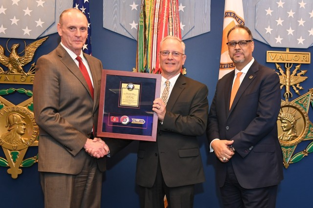 Michael J. Lombardi of Army Futures Command's C5ISR Center receives a 2018 LEAP award from (left) Mr. Robin P. Swan, Director for the Army Office of Business Transformation, and (right) Dr. Charles Brandon, Director for the office's Process Improvement Program. The LEAP award is the command's first award for process improvement.