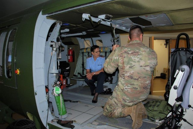 Maj. Gen. Gesine Kruger, Commander for the German Bundeswehr Medical Academy (pictured center in the Flight Paramedic Training Simulator) and her delegation observe training and tour the Critical Care Flight Paramedic Course at the Health Readiness Center of Excellence, JBSA-Fort Sam Houston, Texas, June 6, 2019.