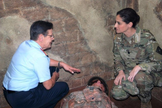 During a visit to the Medical Education and Training Campus, on June 5, 2019, Maj. Gen. Gesine Kruger (Left), Commander for the German Bundeswehr Medical Academy received a brief and tour of combat medic simulated trauma scenario training from Lt. Col. Nadia Pearson, Department Chair, Combat Medic Training, Health Readiness Center of Excellence.