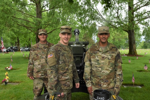 Soldiers from the Oregon Army National Guard's Alpha Battery, 2nd Battalion, 218th Field Artillery Regiment, manning a howitzer at a Memorial Day ceremony at the Willamette National Cemetery, Portland, Oregon, pose for a photograph May 27.
