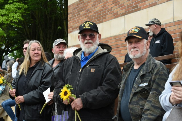 Some of the people who attended a Memorial Day ceremony at the Willamette National Cemetery, Portland, Oregon, pose for a photograph May 27.