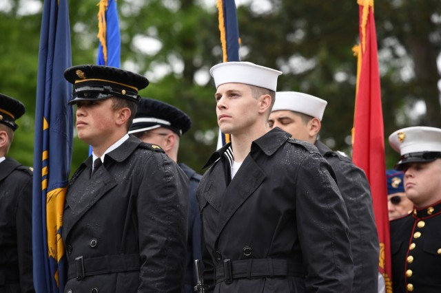 The Willamette National Cemetery Joint Service Honor Guard prepare to post the nation's colors at a Memorial Day ceremony at the Willamette National Cemetery, Portland, Oregon, pose for a photograph May 27.