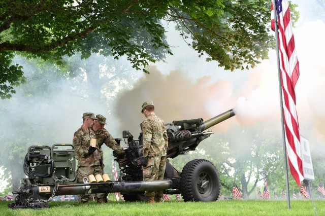 Soldiers from the Oregon Army National Guard's Alpha Battery, 2nd Battalion, 218th Field Artillery Regiment, fire a howitzer salute during a Memorial Day ceremony at the Willamette National Cemetery, Portland, Oregon, May 27.