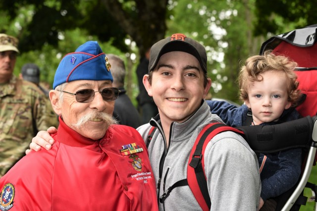 Jim Pernetti, left, Marine Corps Vietnam veteran and now a member of the 1st Marine Division Association, poses for a photograph at a Memorial Day ceremony at the Willamette National Cemetery, Portland, Oregon, May 27.