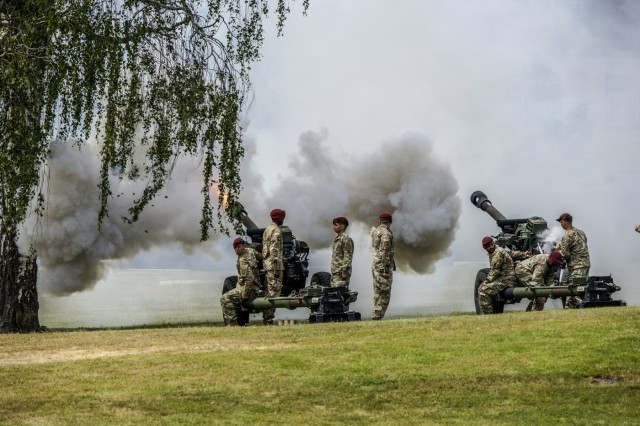 U.S. Army Soldiers assigned to 4th Battalion, 319th Field Artillery Regiment, fires 105mm Howitzers for a changing of command ceremony for Brig. Gen. Christopher C. LaNeve, outgoing commander of 7th Army Training Command (7th ATC) and Brig. Gen. Christopher R. Norrie, incoming commander of 7th ATC, on the parade field, Tower Barracks, Germany, June 11, 2019. The Change of Command ceremony represents the passing of command from LaNeve to Norrie. (U.S. Army photo by Sgt. Christopher Stewart)
