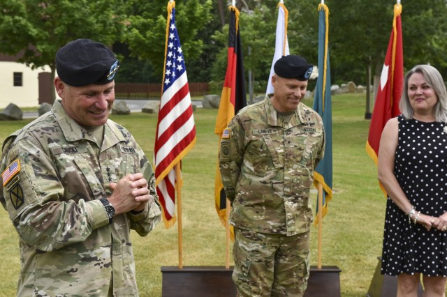 U.S. Army Lt. Gen. Christopher G. Cavoli, commander of U.S. Army Europe, speaks about Brig. Gen. Christopher C. LaNeve, outgoing commander of 7th Army Training Command (7th ATC), and his wife Kimberly, at an award ceremony just before 7th ATC's Change of Command ceremony on the parade field at Tower Barracks, Germany, June 11, 2019. The Change of Command ceremony represents the passing of command from LaNeve to Brig. Gen. Christopher R. Norrie, incoming 7th commander. (U.S. Army photo by Sgt. Christopher Stewart)