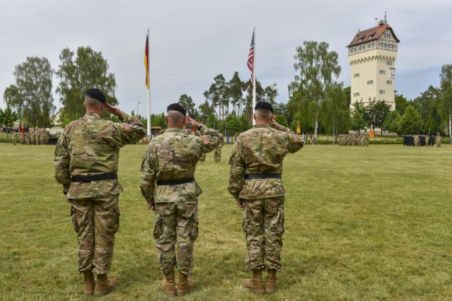 U.S. Army Brig. Gen. Christopher R. Norrie (left), incoming commander of 7th Army Training Command (7 ATC), Lt. Gen. Christopher G. Cavoli, commander of U.S. Army Europe, and Brig. Gen. Christopher C. LaNeve, outgoing commander of 7th ATC, render a salute to the colors during a Change of Command ceremony on the parade field at Tower Barracks, Germany, June 11, 2019. The Change of Command ceremony represents the passing of command from LaNeve to Norrie. (U.S. Army photo by Sgt. Christopher Stewart)