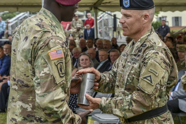 "U.S. Army Brig. Gen. Christopher C. LaNeve, the outgoing commander of 7th Army Training Command (7th ATC), receives a spent howitzer round, the ""last round fired,"" from 7th ATC's Change of Command ceremony on the parade field on Tower Barracks, Germany, June 11, 2019. The Change of Command ceremony represents the passing of command from LaNeve to Brig. Gen. Christopher R. Norrie, the incoming commander of 7th ATC. (U.S. Army photo by Sgt. Christopher Stewart)"