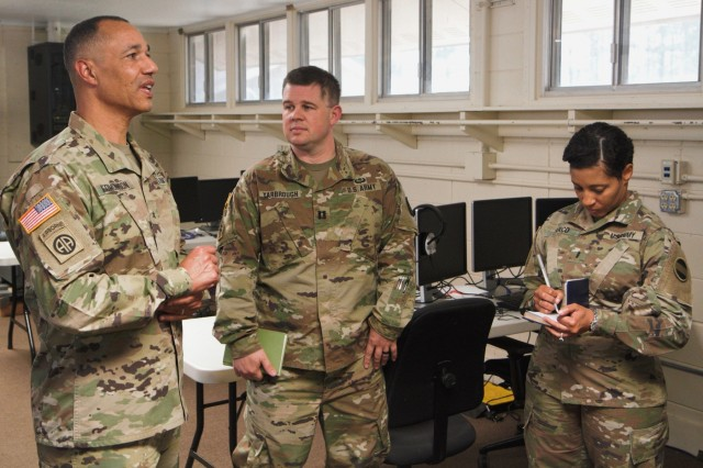 Brig. Gen. Robert Edmondson, deputy chief of staff and chief information officer for FORSCOM (G6) visits with Capt. Joseph Yarbrough, brigade network operations officer, during a visit to Camp Shelby, Miss. on June 4, 2019, as Chief Warrant Officer 3 Ancuinette Zarco takes notes. Yarbrough's unit, the S6 section of the 31st CBRN (Chemical, Biological, Radiological, Nuclear) Brigade from the Alabama Army Guard, is conducting a joint digital integration exercise during its annual training.