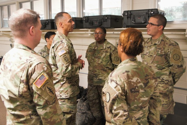 Brig. Gen. Robert Edmondson, deputy chief of staff and chief information officer for FORSCOM (G6) speaks with a group of soldiers from the S6 section of the 31st CBRN (Chemical, Biological, Radiological, Nuclear) Brigade from the Alabama Army Guard during a visit to Camp Shelby, Miss. on June 4, 2019. These soldiers are participating in a Joint Digital Integration Exercise during their annual training.