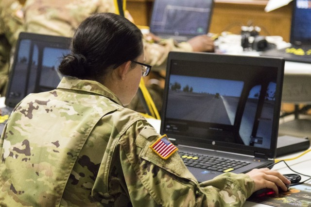 Spc. Jordyn McGuire, a Soldier with Alpha Company, 777th Aviation Support Battalion, 345th Combat Sustainment Support Battalion, 90th Troop Command, trains on convoy procedures through a Virtual Battle Space III (VBS3) desktop simulation. VBS3 allows Soldiers to simulate a range of scenarios, including route clearance, improvised explosive device training, unmanned aerial systems training and more.