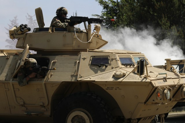 Soldiers with the 1186th Military Police Company, Oregon Army National Guard, perform convoy operations and personal security training June 2, 2019, during annual training at Camp Rilea Armed Forces Training Center, Warrenton, Oregon. The MPs reacted to an ambush with incoming fire from Soldiers role-playing the opposition forces along the route while securing a notional distinguished visitor. Other Soldiers role-played casualties allowing for the medics to receive training also.