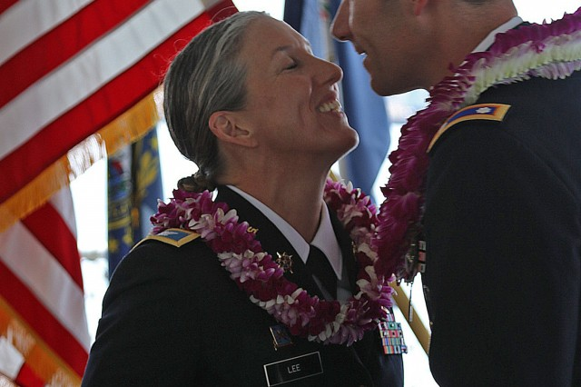 PEARL HARBOR, Hawaii - Two U.S. Army officers who began their own careers 27 years and one day prior, by commissioning one another, retired from their individual service to the nation just as they started it, together. Both Col. Bethany L. Lee, Assistant Chief of Staff, G-1, 9th Mission Support Command, and Lt. Col. Carleton A. Lee, U.S. Indo-Pacific Command J6,  became a part of Army history with a combined total of 54 years, 4 months and 8 days of service to the nation. Pictured here, from the deck of the USS Missouri, where the treaty ending World War II in the Pacific was officially signed, they completed their Army careers with an official retirement ceremony. (Photo by Crista Mary Mack, U.S. Army)