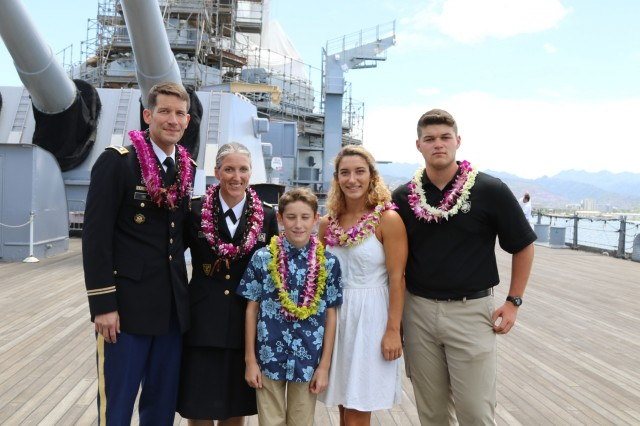 PEARL HARBOR, Hawaii - From left to right, U.S. Army Lt. Col. Carleton A. Lee, Col. Bethany L. Lee, son Kieran Lee, daughter Regan, and son Brennan pose together at the Lee dual retirement ceremony on the deck of the USS Missouri, where the treaty ending World War II in the Pacific was officially signed. (Photo by Crista Mary Mack, U.S. Army)