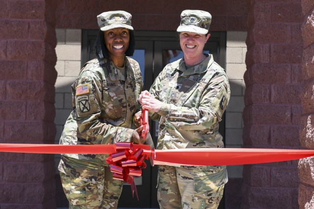 Lt. Col. Julia Donley (right), 302nd Signal Battalion commander, and Maj. Keya Riggins, USASA Camp Roberts commander, cut the ribbon to the new USASA headquarters building June 4 at Camp Roberts.