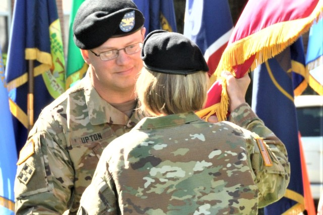 New MCAAP Commander Col. Shane M. Upton receives the McAlester Army Ammunition Plant unit colors from Brig. Gen. Michelle M.T. Letcher in the change of command ceremony June 12.