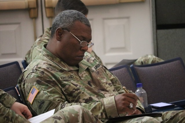 The senior enlisted leader of the 741st Military Intelligence Battalion, Command Sgt. Maj. Michael Kirkland, takes notes during Leader Professional Development training hosted by the U.S. Military Academy's Center for Junior Officers May 31, at Fort Meade's Post Theater. (Photo by Sgt. Gary R. Smith, 704th Military Intelligence Brigade Public Affairs Office)