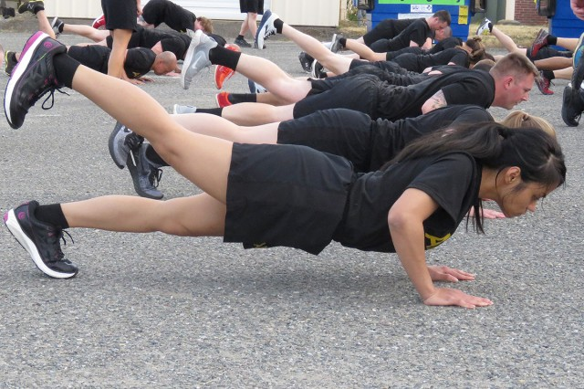 Sgt. Rochelle Kaikala practices her form during a morning physical training session that opened each day of Madigan Army Medical Center's first NCO Offsite conference June 6 and 7 at the Club at McChord Field on Joint Base Lewis-McChord, Wash.