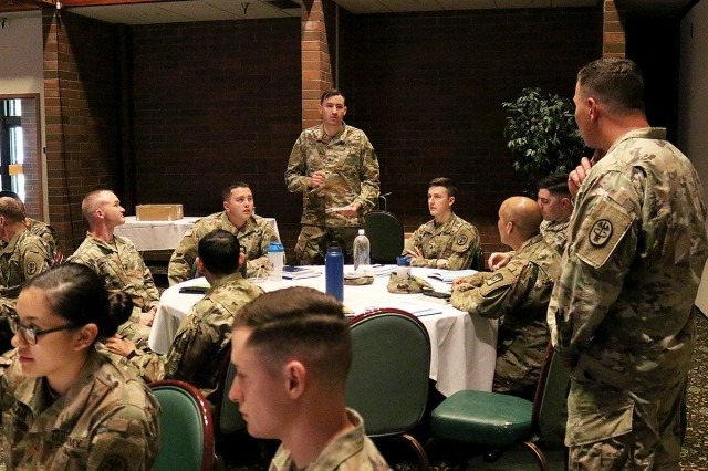 Master Sgt. Dennis Meyer (right), listens as an NCO shares the challenges and successes of counseling at Madigan Army Medical Center's first NCO Offsite conference June 7 at the Club at McChord Field on Joint Base Lewis-McChord, Wash.