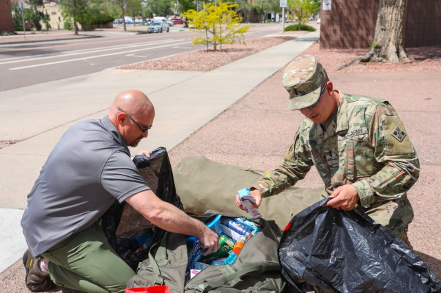 U.S. Army 1st Lt. Johnathan W. Kriegh, right, an infantry officer assigned to 1st Battalion, 12th Infantry Regiment, 2nd Infantry Brigade Combat Team, 4th Infantry Division, helps a member of the Crawford House, a local veterans' support center, inventory personal hygiene items, May 17, 2019, at the Crawford House in Colorado Springs, Colorado. Soldiers from 1st Bn., 12th Inf. Reg., 2IBCT, conducted a golf tournament to help gather items to donate to the support center. (U.S. Army photo by Staff Sgt. Neysa Canfield)
