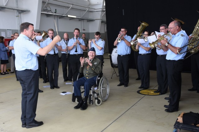 "The German military band played a special performance for retired U.S. Air Force Col. Gail Halvorsen, the famed ""Candy Bomber"" in the Berlin Airlift, before a memorial service June 11, 2019, at Lucius D. Clay Kaserne airfield in Wiesbaden, Germany. The event commemorated those who participated in the historic military operation in 1948 to 1949. (U.S. Army photo by Jessica Ryan)"