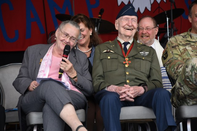"Retired U.S. Air Force Col. Gail Halvorsen, the famed ""Candy Bomber"" in the Berlin Airlift and Mercedes Wild, the subject of the children's book ""Mercedes and the Chocolate Pilot,"" share memories during a memorial service June 10, 2019, at Lucius D. Clay Kaserne airfield in Wiesbaden, Germany. Halvorsen and Wild formed a lasting friendship decades after the Berlin Airlift as Wild remembered Halvorsen as the man who gave her candy and other goods during the Berlin blockade. (U.S. Army photo by Jessica Ryan)"