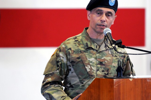 U.S. Army Col. Manuel Pozo-Alonso addresses those in attendance during a change of commander ceremony June 13 in Sembach, Germany.  Pozo-Alonso took command of Dental Health Command Europe from Col. Stephen Tanner.