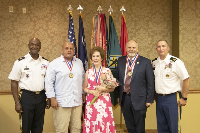 Army Training Center and Fort Jackson Commander Brig. Gen. Milford 'Beags' Beagle, Jr , left, and Post Command Sgt. Maj. Jerimiah Gan, far right, welcome the 2019 Fort Jackson Hall of Fame inductees during a luncheon in their honor June 6 at the NCO Club. This year's inductees include retired 1st Sgt. Pete Lara, left of center, Jo Lynn Allen, center, who accepted the honor on behalf of her late husband Maj. Gen. James B. Allen, Jr, and retired Col. J.R. Sanderson.