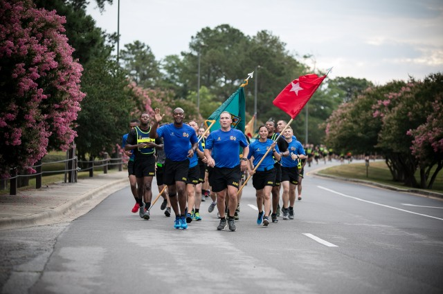 Army Training Center and Fort Jackson Commander Brig. Gen. Milford 'Beags' Beagle and Post Command Sgt. Maj. Jerimiah Gan lead the pack during the June 7 installation run. The run helped close out the weeklong Victory Week that celebrated the installations 102nd birthday.