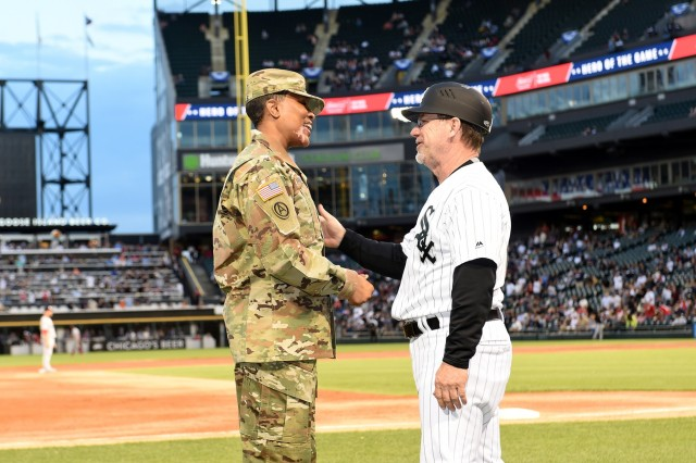 Master Sgt. Shandrel Daniels meets Chicago White Sox third base coach, Nick Capra, during the White Sox vs Washington Nationals game at Guaranteed Rate Field, June 11, 2019. Daniels attended the game to be honored during the 'Hero of the Game' recognition there. Daniels, who has served for 31 years with two deployments, was honored in front of a crowd of 17,000. (U.S. Army Reserve photo by Sgt. David Lietz)
