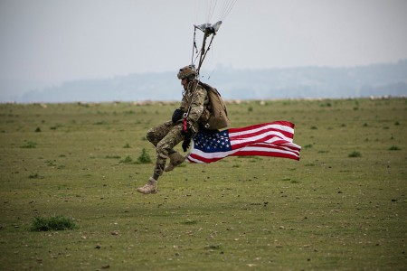 Special Forces Soldier from the 10th Special Forces Group (Airborne) prepares to land on the drop zone near Mont Saint Michel, Avranches, France. This airborne operation celebrates the strong alliance between France and the United States