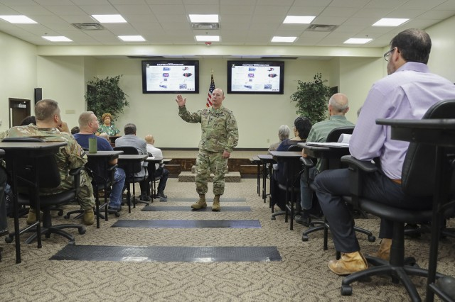 Col. Joel Warhurst speaks to Anniston Army Depot employees during his June 5, 2019, town hall meeting.