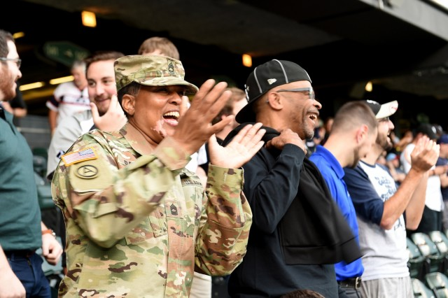 Master Sgt. Shandrel Daniels cheers during the Chicago White Sox vs Washington Nationals game at Guaranteed Rate Field, June 11, 2019. Daniels attended the game to be honored during the 'Hero of the Game' recognition there. Daniels, who has served for 31 years with two deployments, was honored in front of a crowd of 17,000.