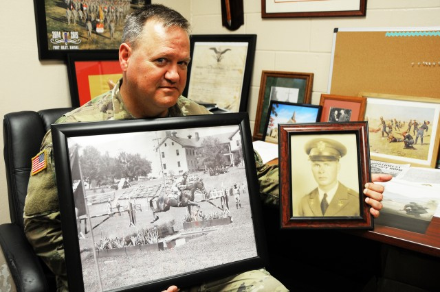 "Chaplain (Capt.) Chris Cairns, U.S. Army Warrant Officer Career College chaplain, holds photos of his great uncle, Maj. Gen. Bogardus Snowden ""Bugs"" Cairns -- namesake of Cairns Army Airfield -- on horseback, and his grandfather, retired Air Force Col. Douglas Moore Cairns, who started his career and fought in WWII in the Army."