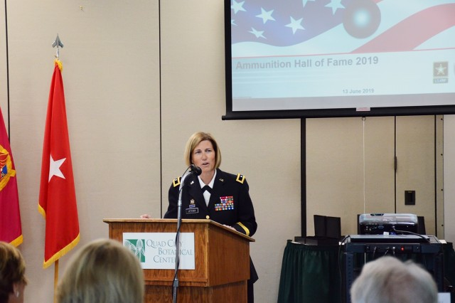 Brig. Gen. Michelle M. T. Letcher, Commanding General, Joint Munitions Command, delivers the keynote address to the audience honoring this year's Ammo Hall of Fame inductees.