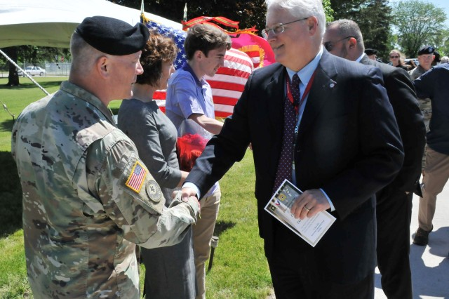 Lt. Col. Stephen Koehler, outgoing IAAAP commander, greets guests following the Iowa Army Ammunition Plant Change of Command Ceremony, June 13.