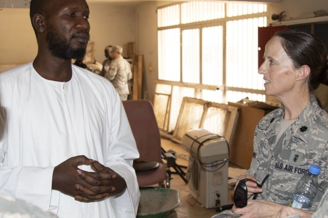 Diop Abdourahmane, Environmental Director, discusses operations with U.S. Air Force Lt. Col. Sarah Davisat the Regional Center Hospital at Tambacounda, Senegal, on April 9. Vermont Guardsmen are working with their Senegalese counterparts to share best practices while providing patient treatment as part of a Medical Readiness Training Exercise (MEDREX), in conjunction with the State Partnership Program.
