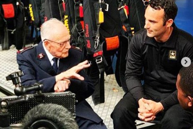 Army Parachute Team (Golden Knights) member Sgt. 1st Class Ryan O'Rourke (right) listens as Harry Read shares his memories of jumping into Normandy on D-Day 75 years ago. The British WWII veteran later completed a tandem jump into Normandy with the British Red Devils parachute demonstration team. (U.S. Army Photo/released)