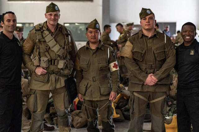 Members of the Army Parachute Team pause for a photo with D-Day reenactors during the 75th anniversary celebration at Normandy, France. (U.S. Army photo/released)