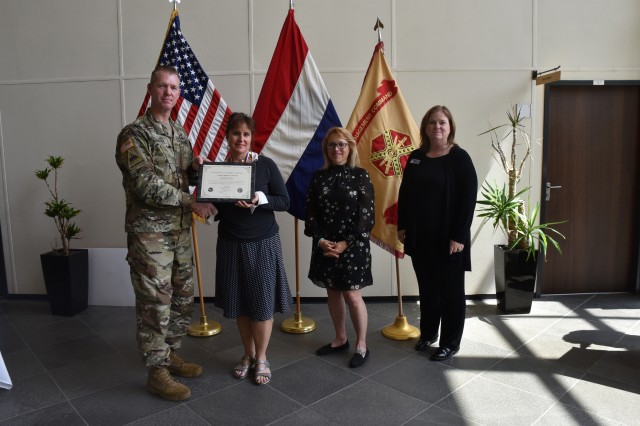 Army Col. Sean Hunt Kuester, USAG Benelux garrison commander, recognized Tri-Border Community volunteers during a formal recognition ceremony June 6, 2019, in Schinnen, The Netherlands. Considered the heart of the Benelux community, volunteers make a meaningful difference in the lives of service members and families each day. Therese Guza received the Civilian Volunteer of the Year award.
