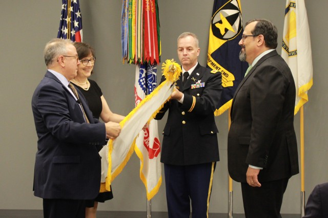 Dr. Barton H. Halpern, Army Research Office director (left) is inducted into the Senior Executive Service by Army Research Laboratory Director Dr. Philip Perconti (right) during a ceremony at the Army Research Office at Research Triangle Park, North Carolina, June 7, 2019.