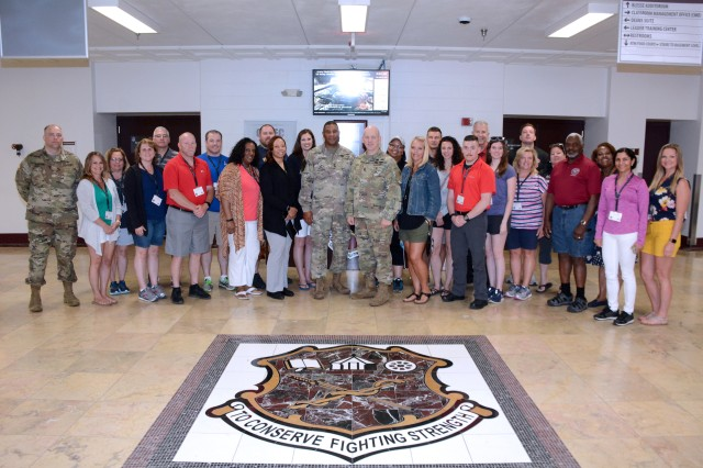 """Maj. Tom Roader, Cleveland Recruiting Battalion (far left) pictured with a group of educators from the Ohio area.  Maj. Gen. Patrick D. Sargent (center left) and Command Sgt. Maj. William """"Buck"""" O'Neal (center right), the U.S. Army Medical Department Center and School, Health Readiness Center of Excellence Commanding General and Command Sergeant Major hosted the educator tour to JBSA-Fort Sam Houston on June 11, 2019 in support of the U.S. Army Recruiting Command's mission."""