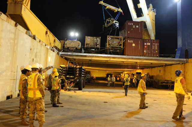 599th personnel wait for the ship's crane to upload cargo and equipment during port operations on the M/V Ocean Jazz at Pearl Harbor on June 7.