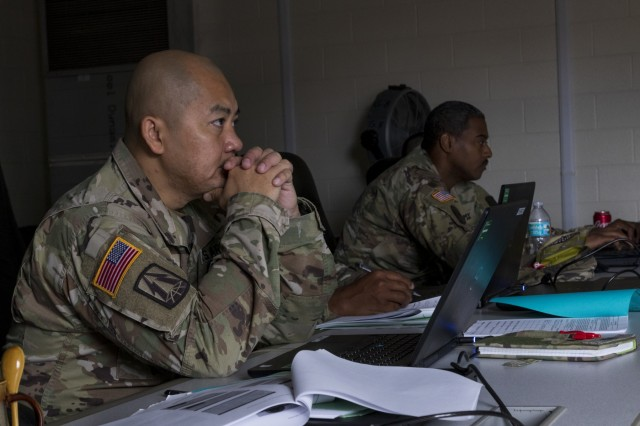 U.S. Army Reserve Lt. Col. James Bush, chief of operations,  335th Signal Command (Theater) watches a video during a Casualty Notification and Assistance Course at the headquarters in East Point, Georgia, June 11, 2019.  The Army provides training to prepare casualty notification and assistance officers for the emotional aftereffects of bearing sad tidings.  (U.S. Army Reserve photo by Capt. David Gasperson)
